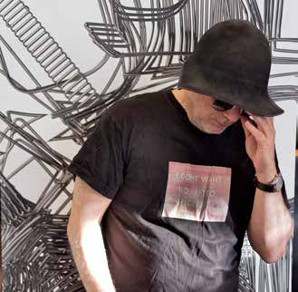 Arad wearing t-shirt printed with Ed Rusha's painting I Don't Want No Retrospective