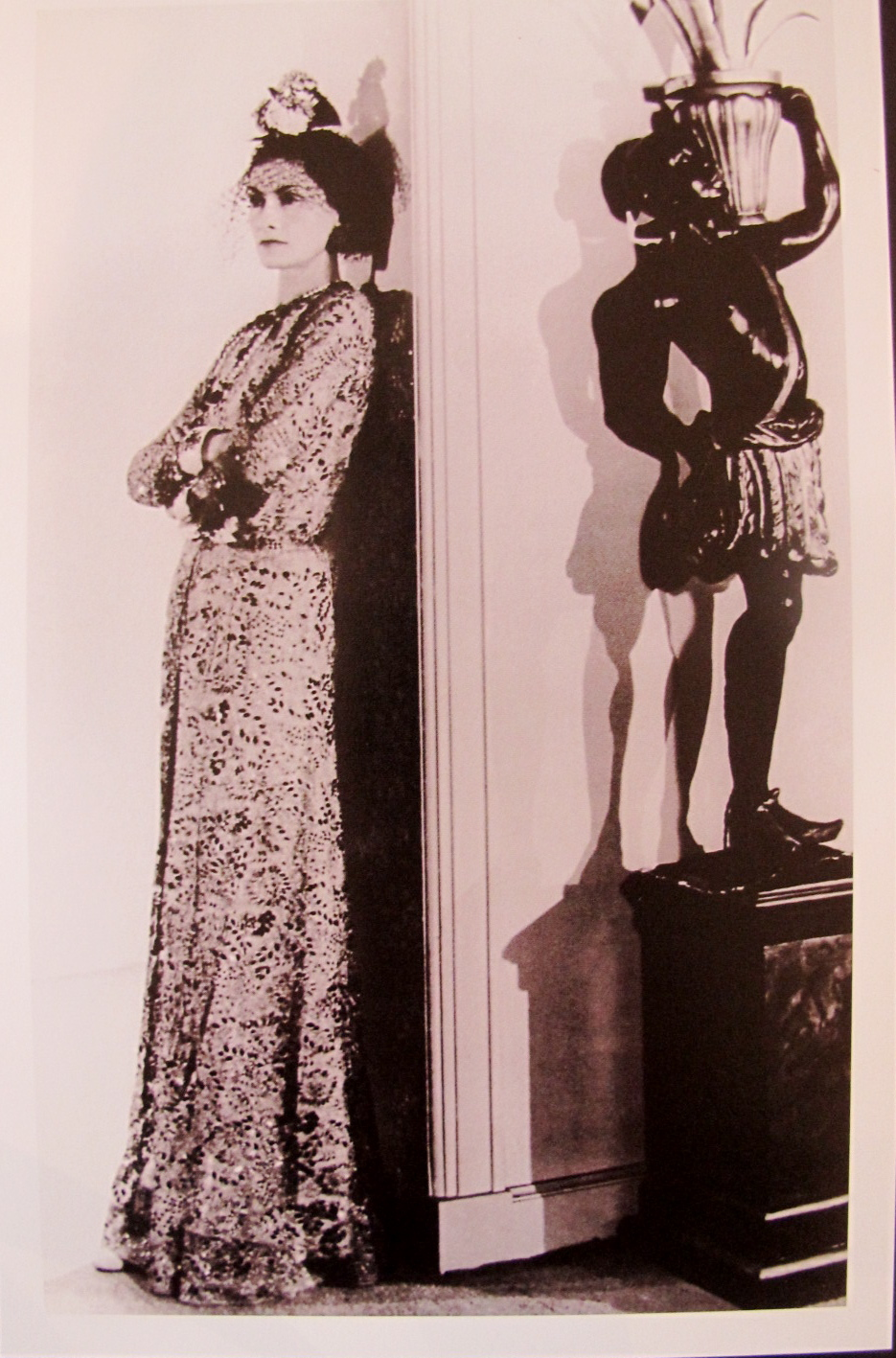 11936 camellias in her hair, baroque cuffs, glittering beside a Venetian statue of a Moor