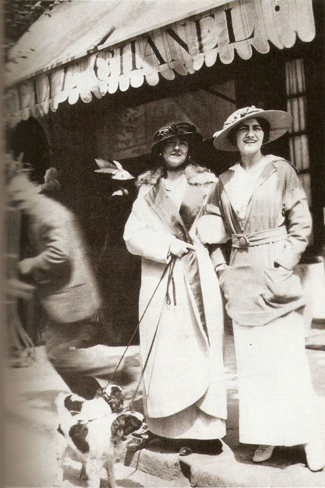 Coco Chanel and her aunt Adrienne in front of her boutique in Deauville, 1913
