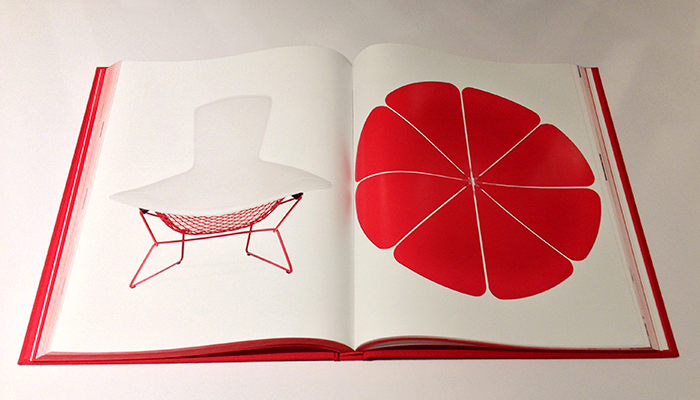 A red Petal Table and a red Bird Chair from Knoll, selected by Jony Ive and Marc Newson, are part of the (RED) Auction 2013