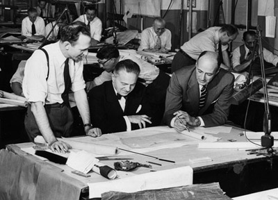 Ely Jacques Kahn (center) at work in the 1950s