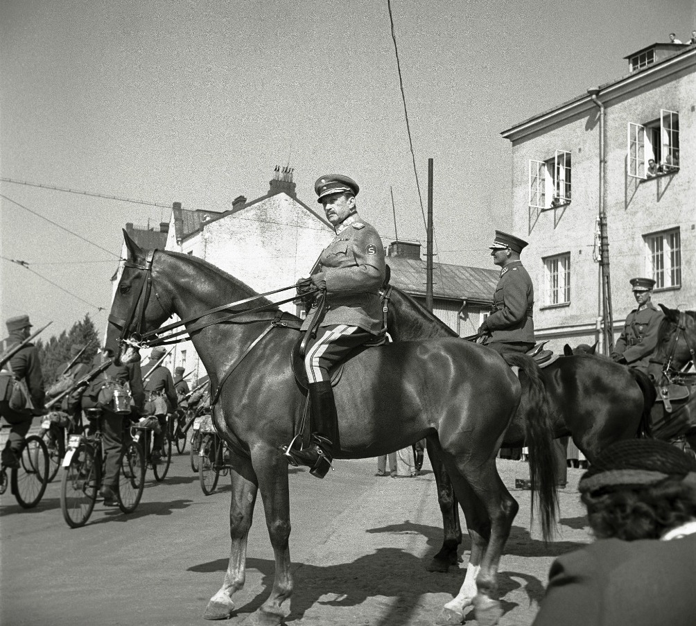 Commander-in-chief, Marshal Carl Gustav Mannerheim reviewing the parade troops in Vyborg