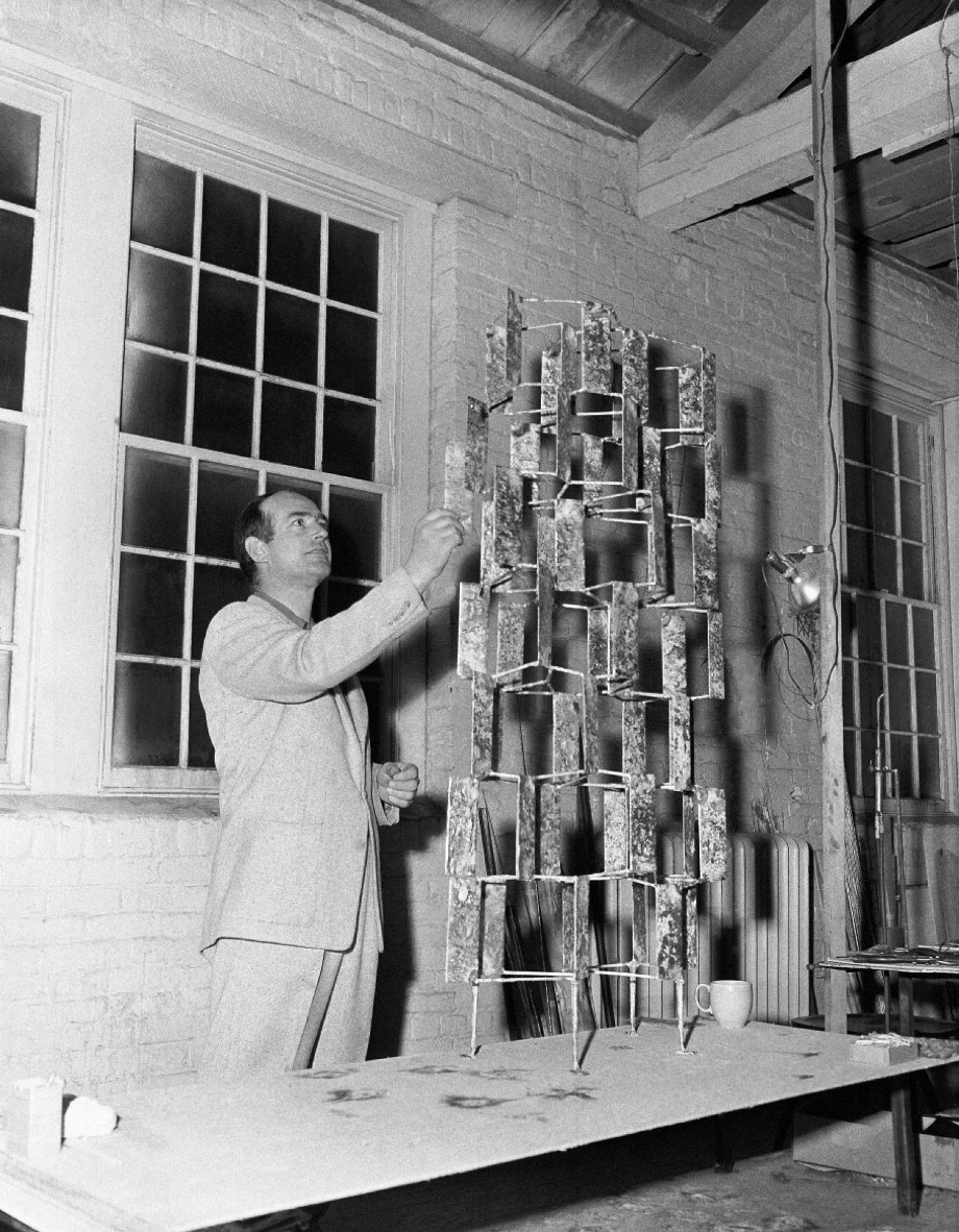 41 year old Harry Bertoia is shown with one of his art pieces, all made in heavy metals, at his studio in 1956