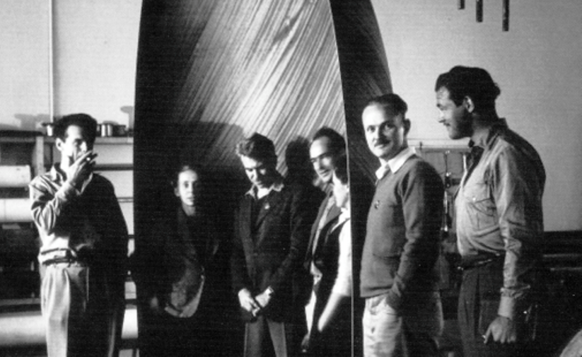 Eames Office staff with plywood glider nose section. Left to right Charles Eames, Marion Overby, Gregory Ain, Harry Bertoia, Ray Eames, William Francis and Norman Bruns