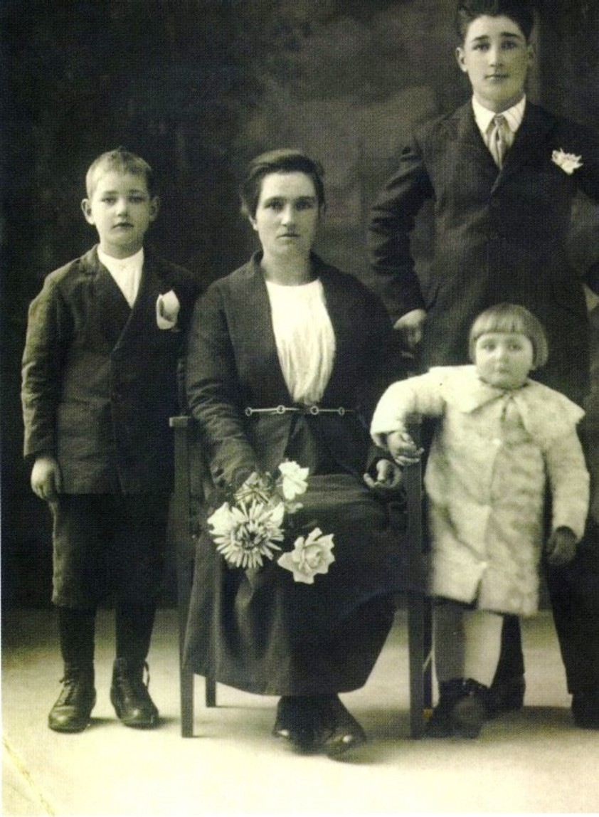 Maria Mussio Bertoia with her children, c 1923. From left Arieto (8 years), Maria (32 years old), Oreste (15 years) and Ave (3 years)