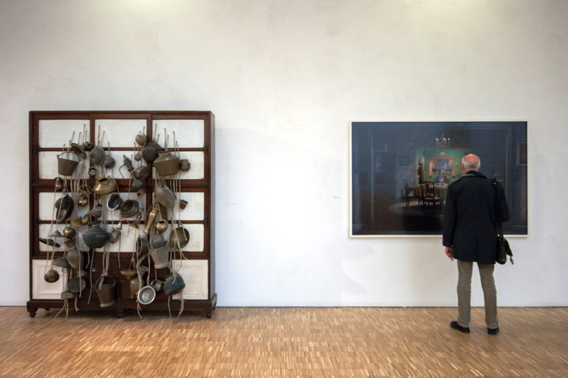Subodh Gupta, Ancestor cupboard, 2012. Right Gregory Crewdson, untitled (Sunday roast), 2005.