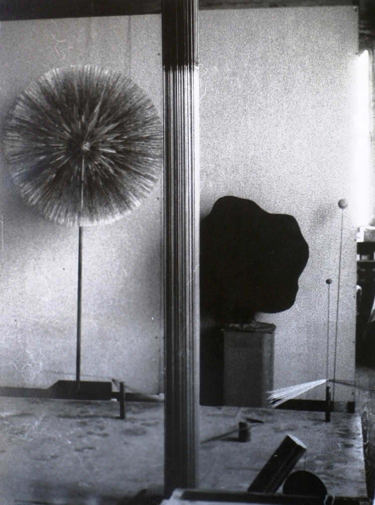 The studio (early 70s), in the foreground a Sound Sculpture, left behind a Dandelion, to the right a Welded Plant.