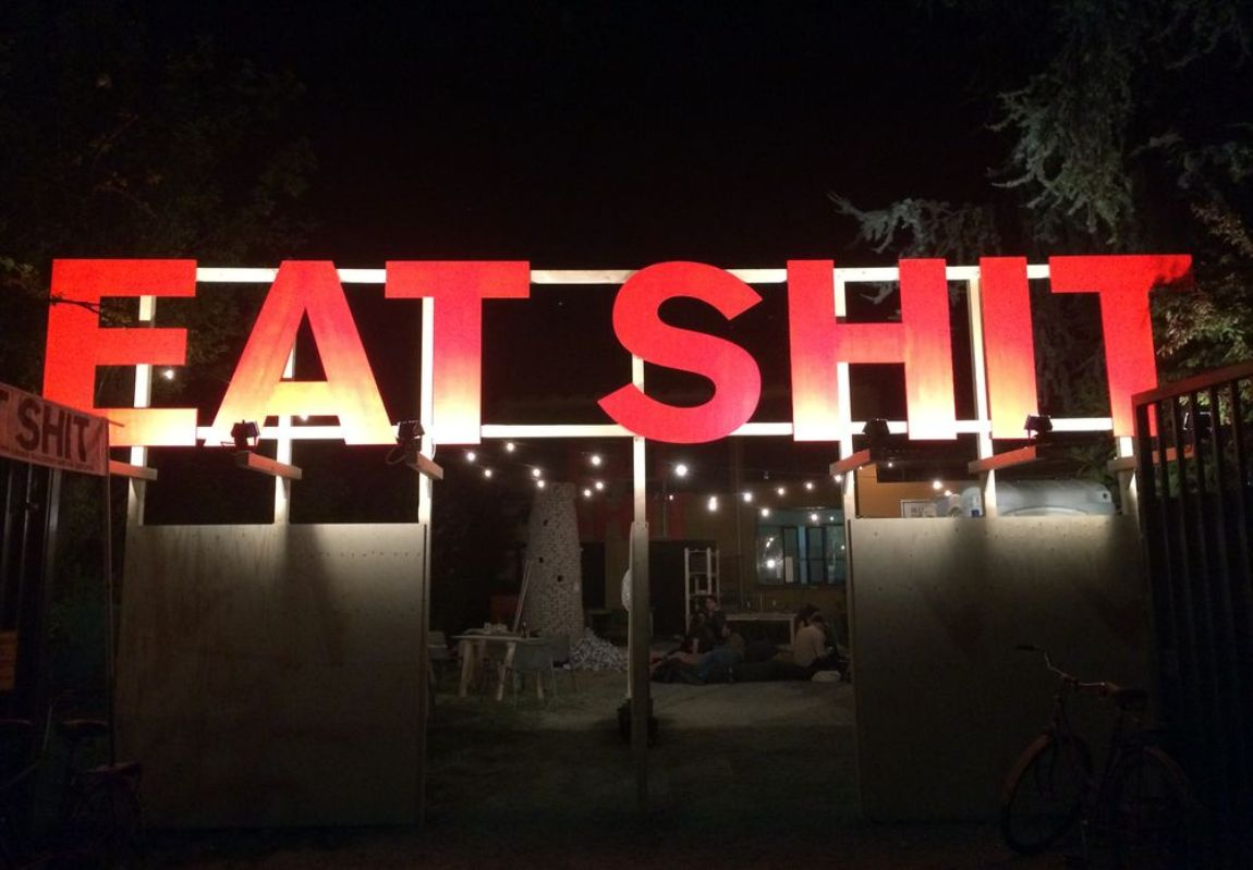 eat shit sign
