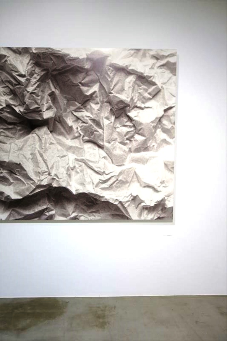 This wrinkled paper was a black and white photograph by Yoshihiko Ueda