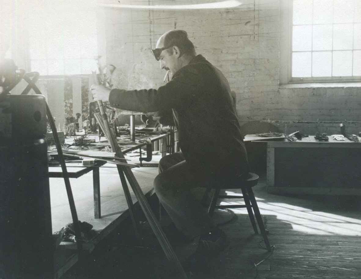 Harry Bertoia, early fifties, in his Bally, PA studio. Bertoia is seated on a stool made by his good friend George Nakashima
