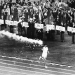 melbourne-1956-australian-athlete-ron-clarke-holder-of-the-junior-mile-record-carries-the-olympic-torch-into-the-stadium-during-the-opening-ceremony